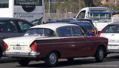 compact car(0.0), automobile(1.0), simca vedette(1.0), family car(1.0), vehicle(1.0), mid-size car(1.0), antique car(1.0), sedan(1.0), classic car(1.0), vintage car(1.0), land vehicle(1.0),