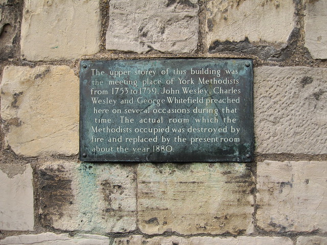 Photo of John Wesley, Charles Wesley, and George Whitefield bronze plaque