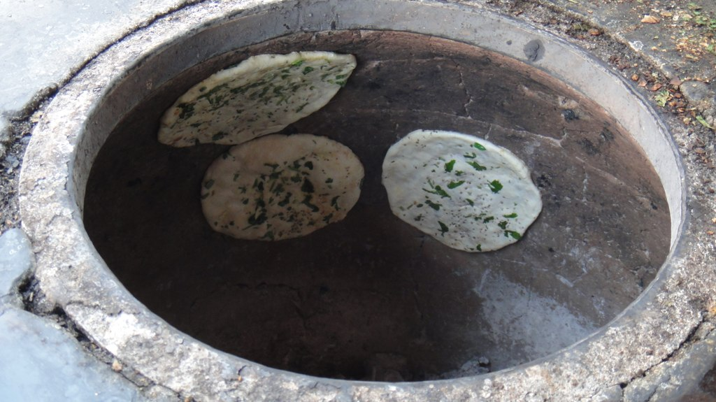 Naan roasting in the tandoor