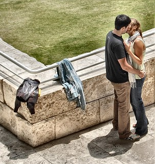 A young couple kissing in the Getty museum, Los Angeles