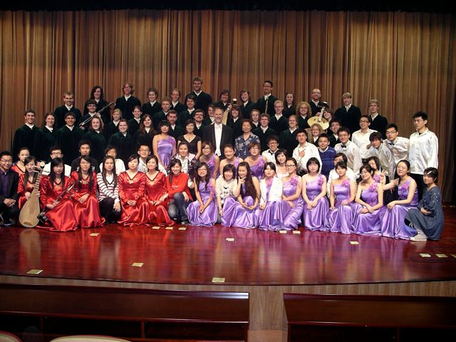 The University of Saskatchewan Greystone Singers with the Xi'an Jiaotong Technical University choir and orchestra in the XJTU auditorium in Xi'an