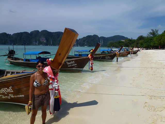 Long boats and the beach, must be Thailand