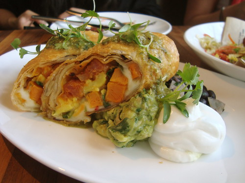 Chimichanga w/ scrambled egg, chorizo spiced pork, pepperjack, yams and Jimmy's mom's salsa verde @ MB Post
