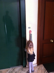 Reaching for the elevator button