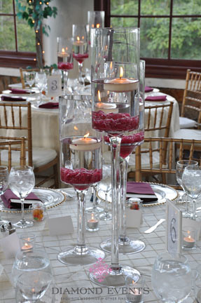 Floating candle centerpieces in pedestal vases