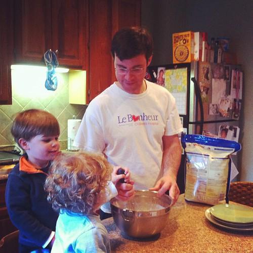Helping daddy make Sunday night pancakes