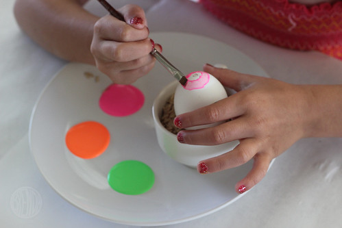 child painting an egg