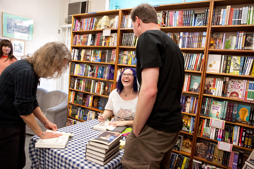 Let the autographing begin! Sara Wilson Etienne signs copies of HARBINGER for fans.