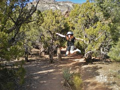 Clare Jumping for Joy on the White Rock La Madre Springs Trail