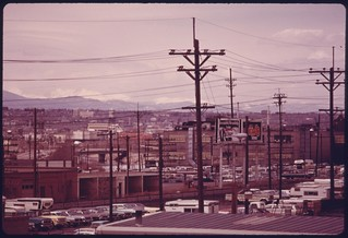 View of Colorado's front range beyond urban and industrial sprawl, 05/1975.