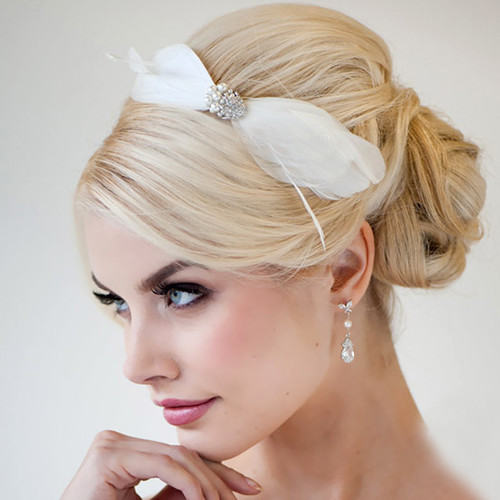 A classy up do complimented by a wonderful hair accessory