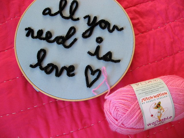 pink yarn to couch inside the heart