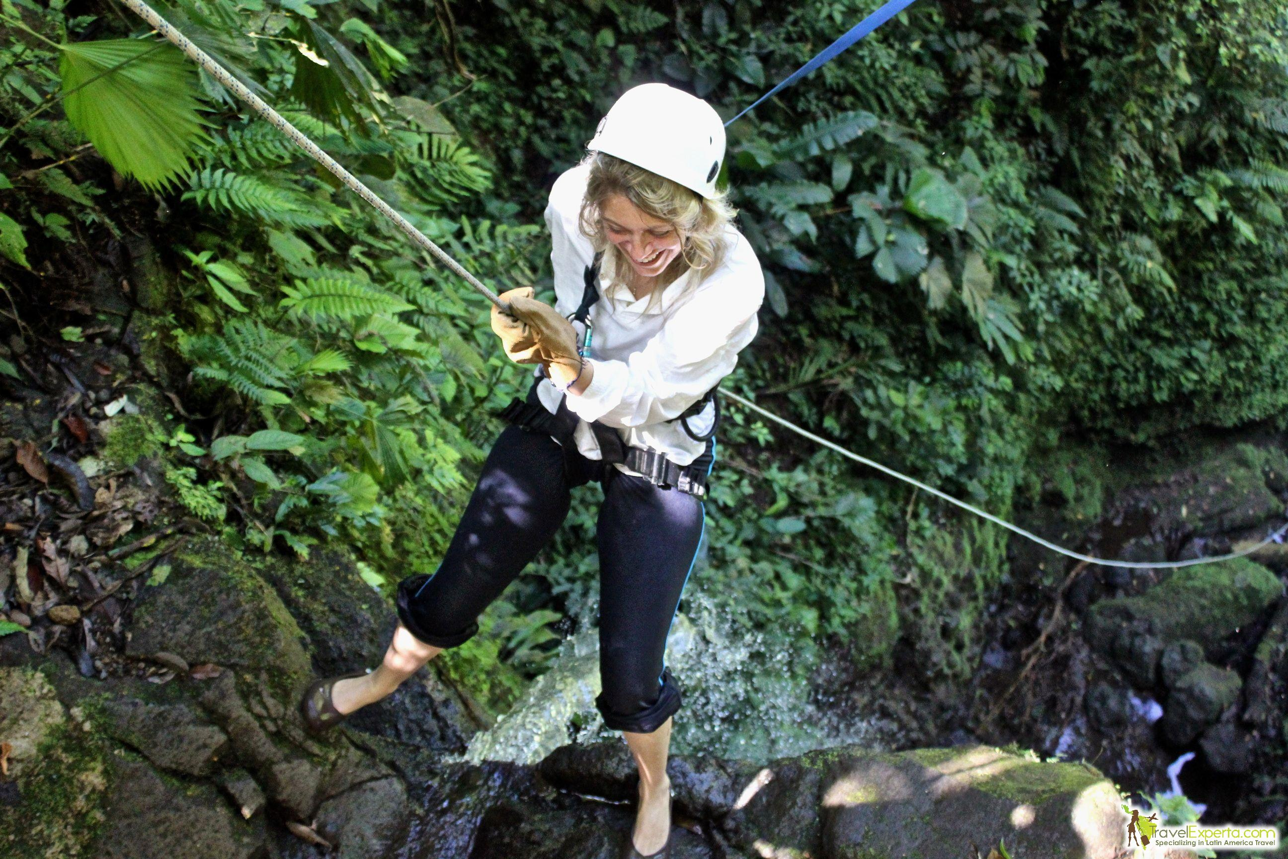 Canyoneering down a waterfall in Arenal, Costa Rica