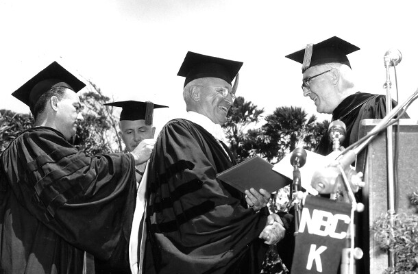 <p>President Harry S Truman receives an honorary degree from UH president Gregg M. Sinclair on April 24, 1953 at Andrews Outdoor Theatre.</p>