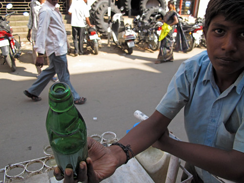 Reusable glass soda water bottles, India