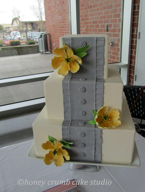 Grey BoxPleated Wedding Cake with Yellow Sugar Blooms