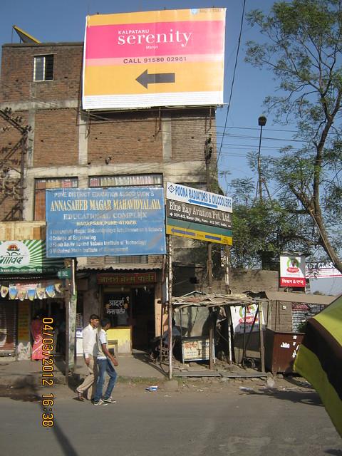 Hoarding at Manjri Phata on Pune Solapur Highway - Visit Kalpataru Serenity, 2 BHK & 3 BHK Flats at Manjri, opp. Navratna Mangal Karyalay, Mahadev Nagar, Pune 412 307