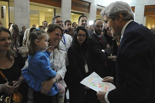 """Secretary Kerry Admires """"S"""" Drawing Presented to Him By Daughter of Embassy Algiers Staffer"""