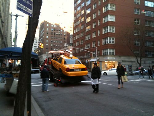 Towing a taxi at 86th and Madison