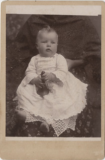 "Baby Holding a Bell Being Held by a ""Hidden Mother"" - Cabinet Card"