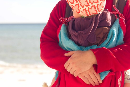 babywearing on the beach