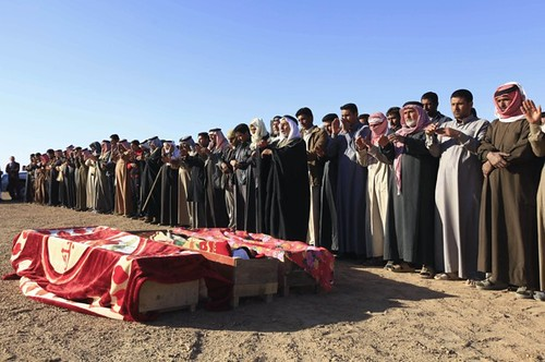 Mourners at a funeral for Iraqi security forces killed on March 5, 2012. Despite the US occupation and their withdrawal peace has still not been won in the Middle Eastern state. by Pan-African News Wire File Photos