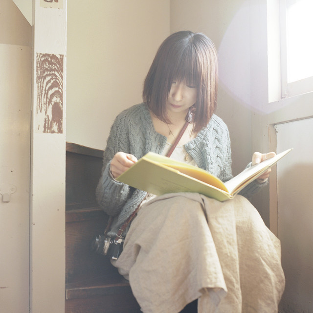 She was reading the old book in the old building.