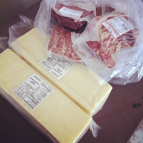 My fridge is happy! Raw cheddar, and pastured beef, sausage, and bacon.