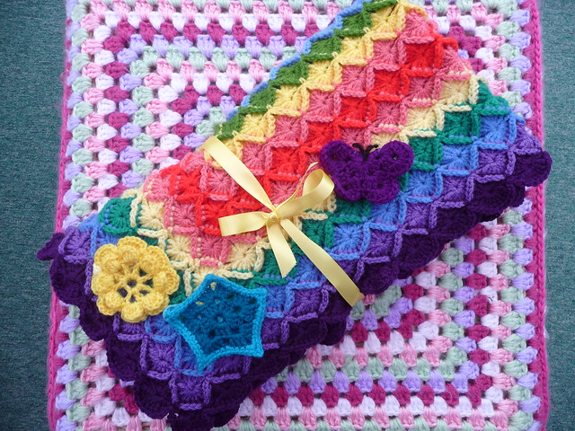 sistersestina (RAV) Has made and donated this gorgeous Blanket! 152 'Radiating Rainbow!'.
