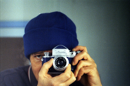 Reflected self-portrait with blue Zenit-C camera and blue hat by pho-Tony