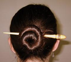 head(0.0), human body(0.0), eyebrow(0.0), eye(0.0), hairstyle(1.0), chignon(1.0), brown(1.0), bun(1.0), hair(1.0), ear(1.0), brown hair(1.0), organ(1.0),