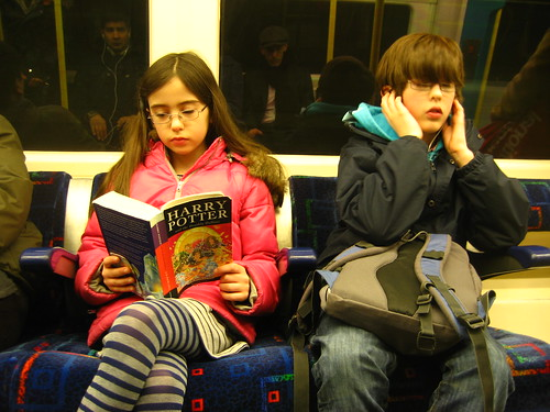 Livvy reading and Cam with iPod on the tube