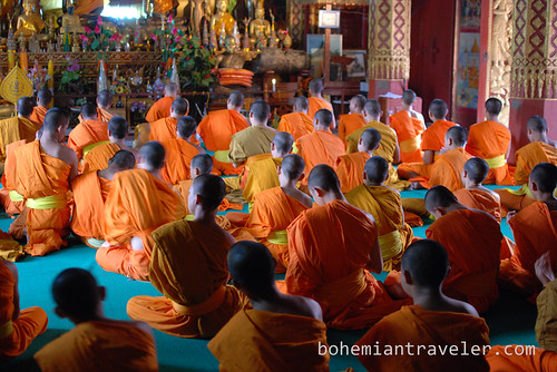 monks chanting at Vat Manorom in Luang Prabang Laos 7