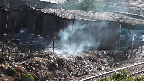Burning trash is not an uncommon site in Kibera