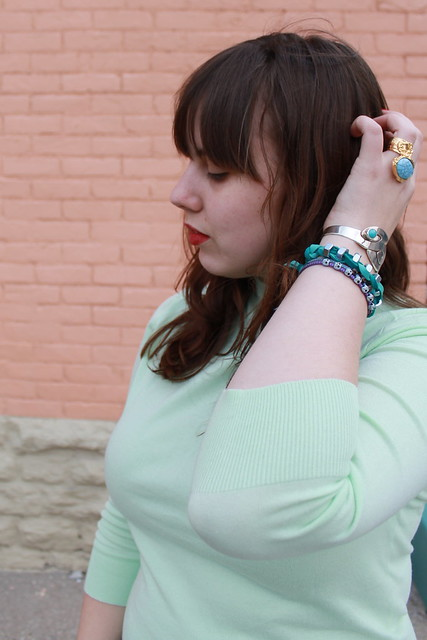 Minty outfit: mint green cardigan worn backward from Jay Crew, Gap cropped black cigarette pants, studded quilted flats, bangles, chunky ring