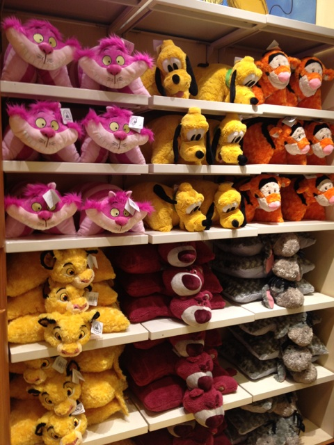 Quite the assortment of Disney pillow pets at Once Upon A Toy. Cheshire Cat, Lotso, Simba ...