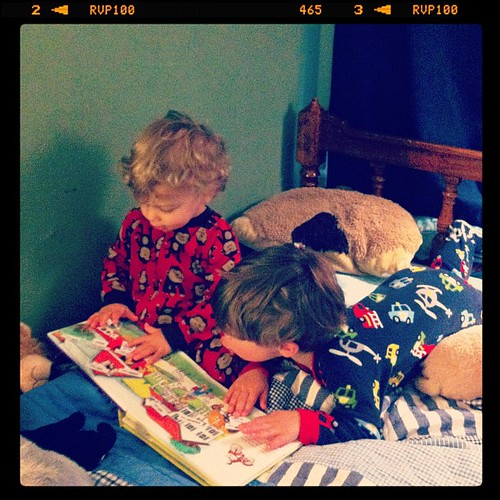 I caught a precious moment between my boys...reading together in the bed. Priceless.