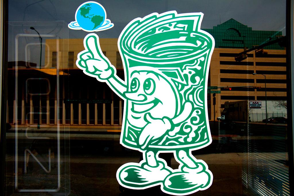 Bundle-of-dollars-spinning-globe--El-Paso