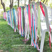 Ribbons tied to the back of ceremony chairs
