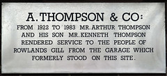 Photo of Arthur Thompson and Kenneth Thompson white plaque