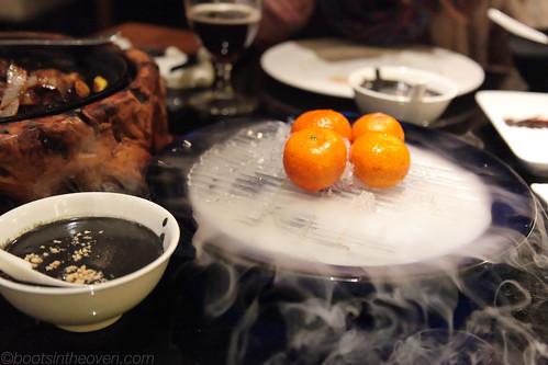 Dessert: black sesame paste with fresh mandarins