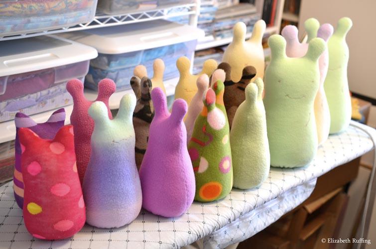 Fleece Hug Me Slugs and Hug Me Bugs in process, original art toys by Elizabeth Ruffing