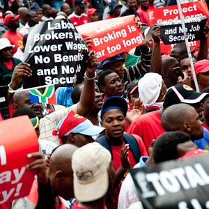 Thousands of workers from the Congress of South African Trade Unions (Cosatu) gathered in Johannesburg, Durban and Cape Town to protest against conditions inside the country. People opposed contract labor and e-tolls. by Pan-African News Wire File Photos
