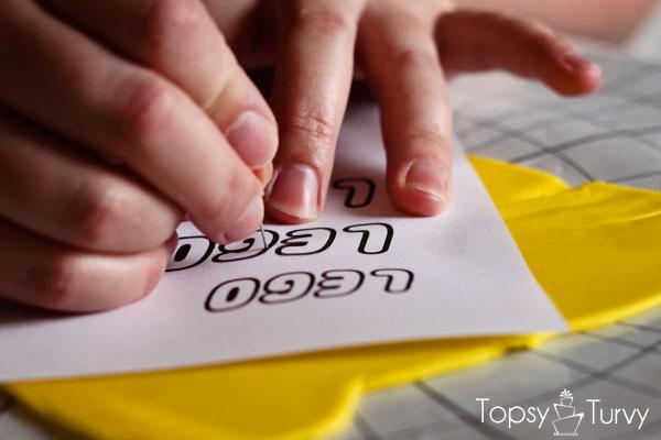 lego-head-cake-tutorial-marking-logo