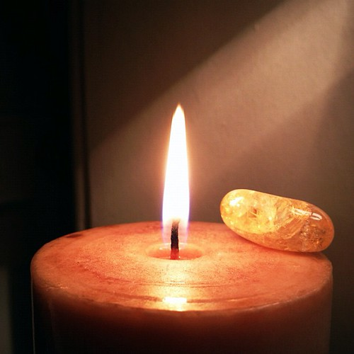 82.365: candle and rock