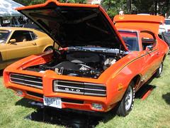 auto show(0.0), automobile(1.0), automotive exterior(1.0), vehicle(1.0), stock car racing(1.0), land vehicle(1.0), muscle car(1.0), pontiac gto(1.0), coupã©(1.0), sports car(1.0),