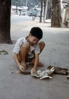 Young Vietnamese boy with hammer and nails