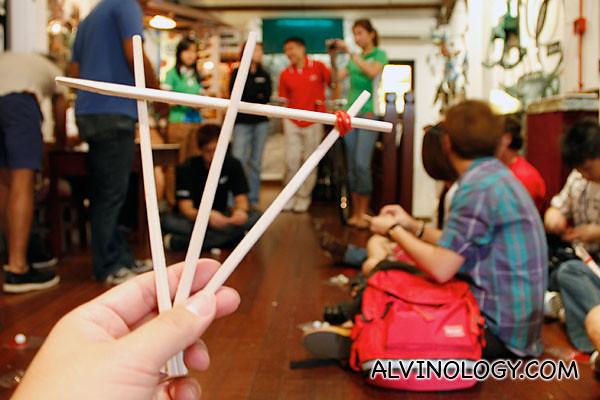 Tie the chopsticks together to form a pyramid