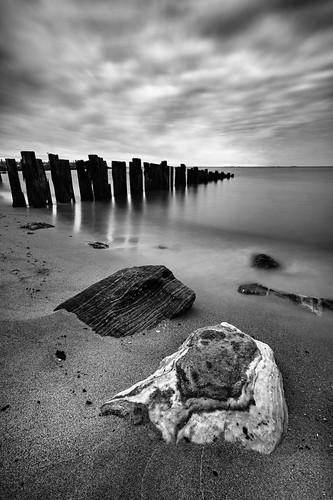 morning blackandwhite beach water clouds sunrise dawn bay pier sand rocks decay shoreline maryland northbeach bayside chesapeake chesapeakebay 123bw