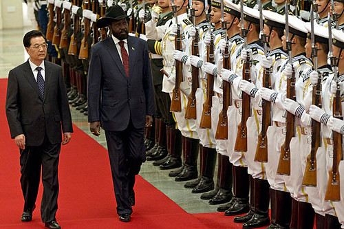 People's Republic of China President Hu Jintao with President of South Sudan Silva Kiir walk past honor guard in Beijing during official visit. Kiir cut short his visit to China amid growing threats of war with Sudan. by Pan-African News Wire File Photos